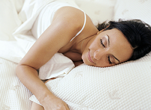 Close-up of woman sleeping in bed.