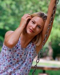 Picture of a young woman sitting on a swing