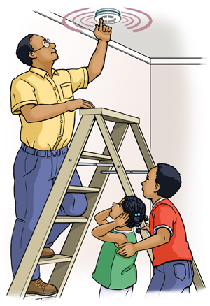 Man on ladder pressing button on ceiling smoke alarm. Two children standing nearby watching.